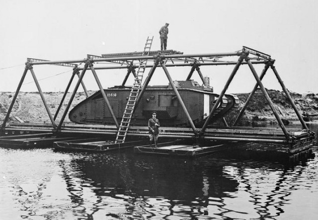 Rafting a Mark V. Tank over a pontoon raft stiffened with Inglis Tubular Bridge. IWM
