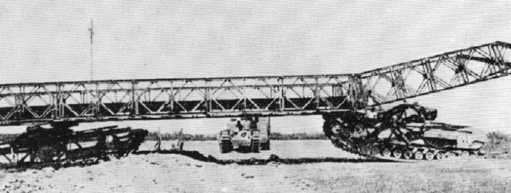 Churchill AVRE propelling a Dalton Mobile Bridger with second vehicle acting as a carrier