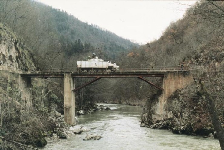 """Juliet"", the Warrior IFV used by Colonel Bob Stewart, Commander of 1st Battalion, Cheshire Regiment, makes its way cautiously over an unsafe bridge at Malankovici. The Warrior is painted in the high visibility white colour scheme used to identify UNPROFOR vehicles in Bosnia."