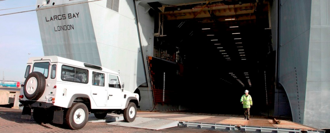 Land-rovers for IFRC being loaded on the RFA Largs Bay, bound for Haiti